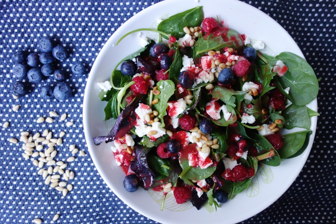 Wild herb salad with raspberries and feta