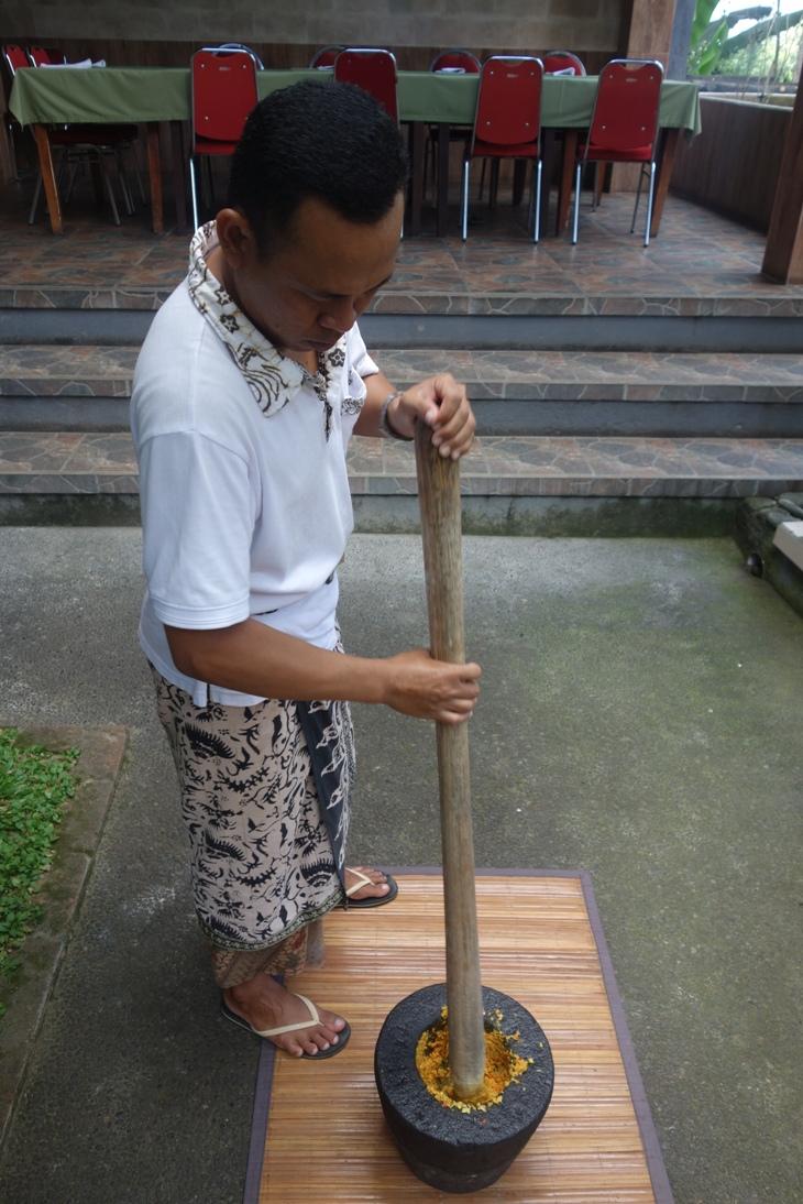 Balinese man grinding